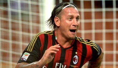 MILAN, ITALY - SEPTEMBER 01:  Philippe Mexes of AC Milan celebrates scoring his team's second goal during the Serie A match between AC Milan and Cagliari Calcio at San Siro Stadium on September 1, 2013 in Milan, Italy.  (Photo by Claudio Villa/Getty Images)